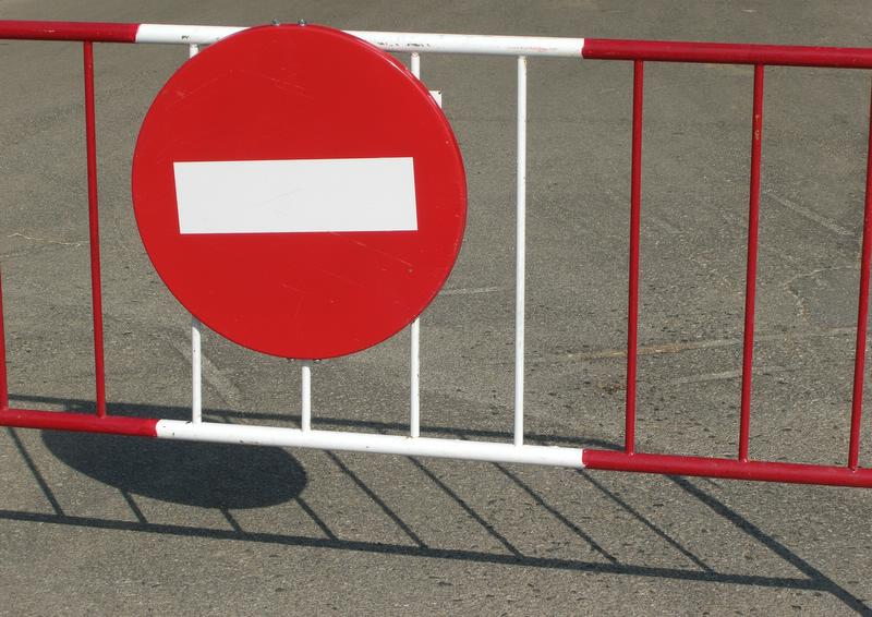 a no entry sign on a gate